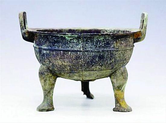 湖北破特大盗墓案追回198件文物